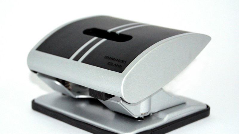 photo of a black and grey holepunch