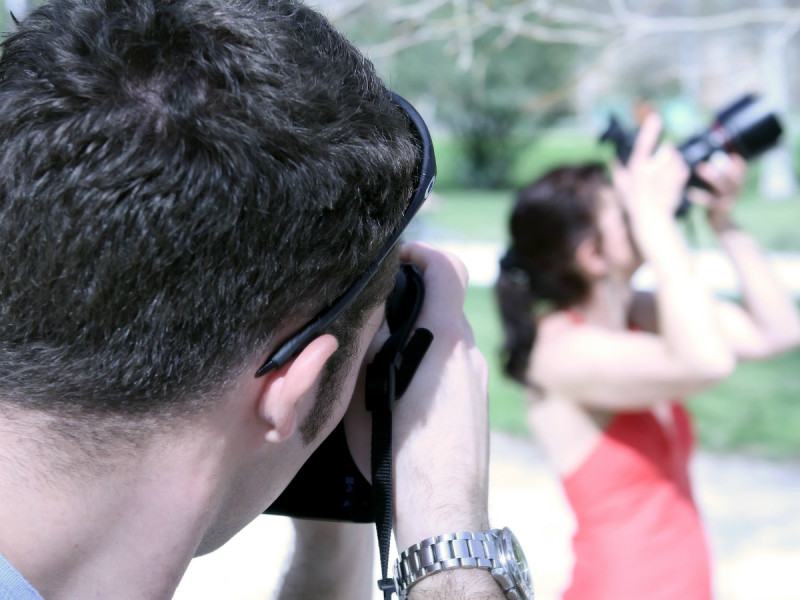 a man taking a photo of a woman who is also taking a photo