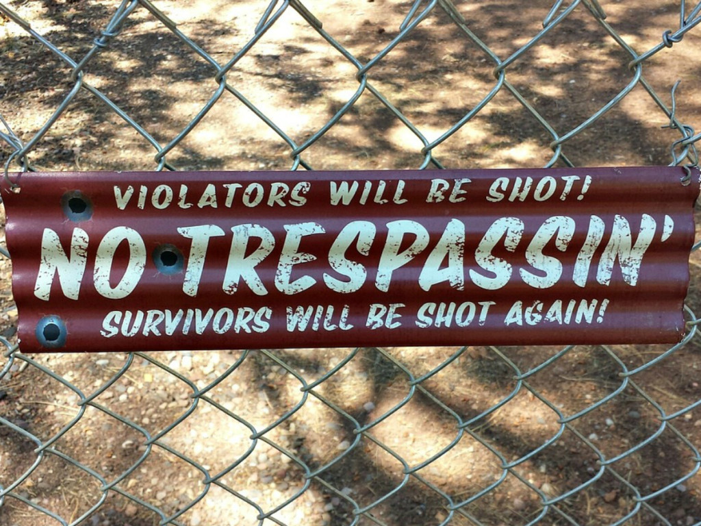 sign on fence saying trespassers will be shot survivors will be shot again