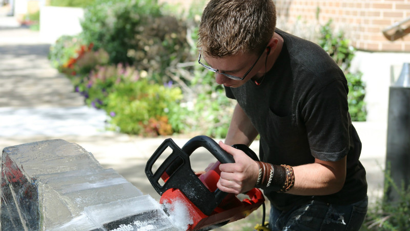 young worker with chainsaw